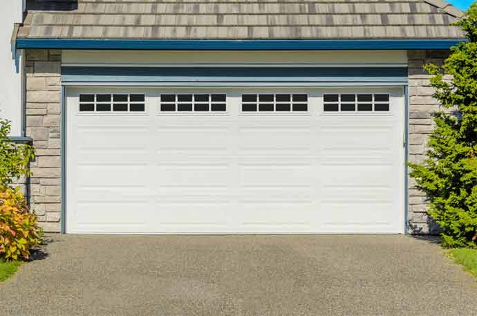 How to Balance a Garage Door With an Extension Spring
